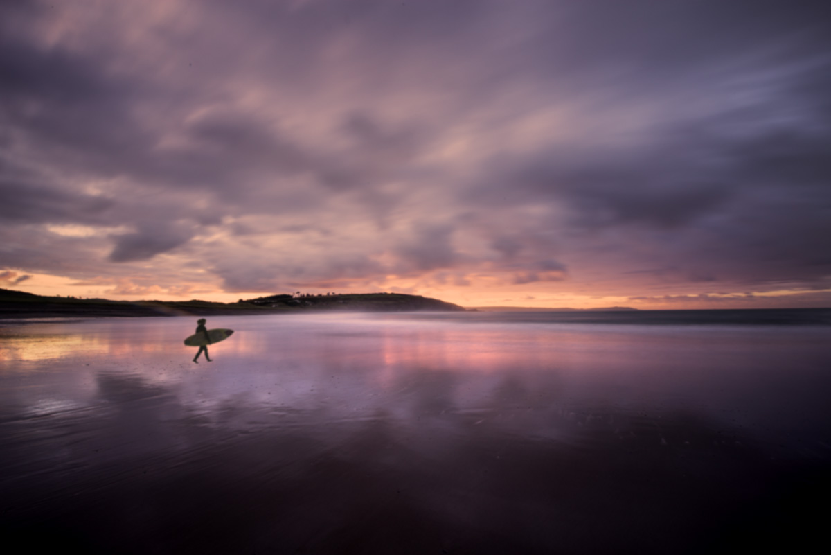 owenahincha beach sunrise surfer