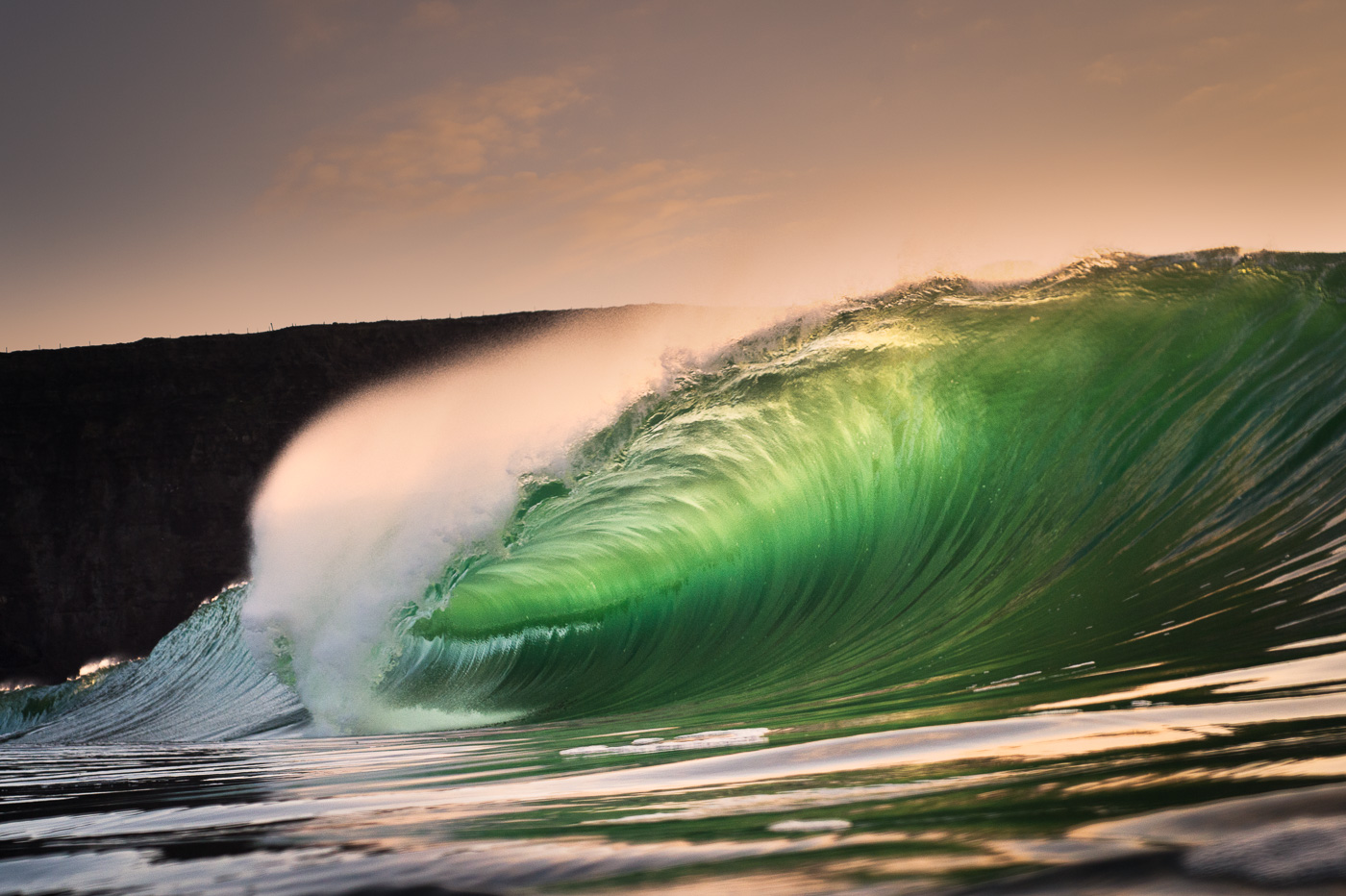 beautiful lit barreling wave ireland riley's