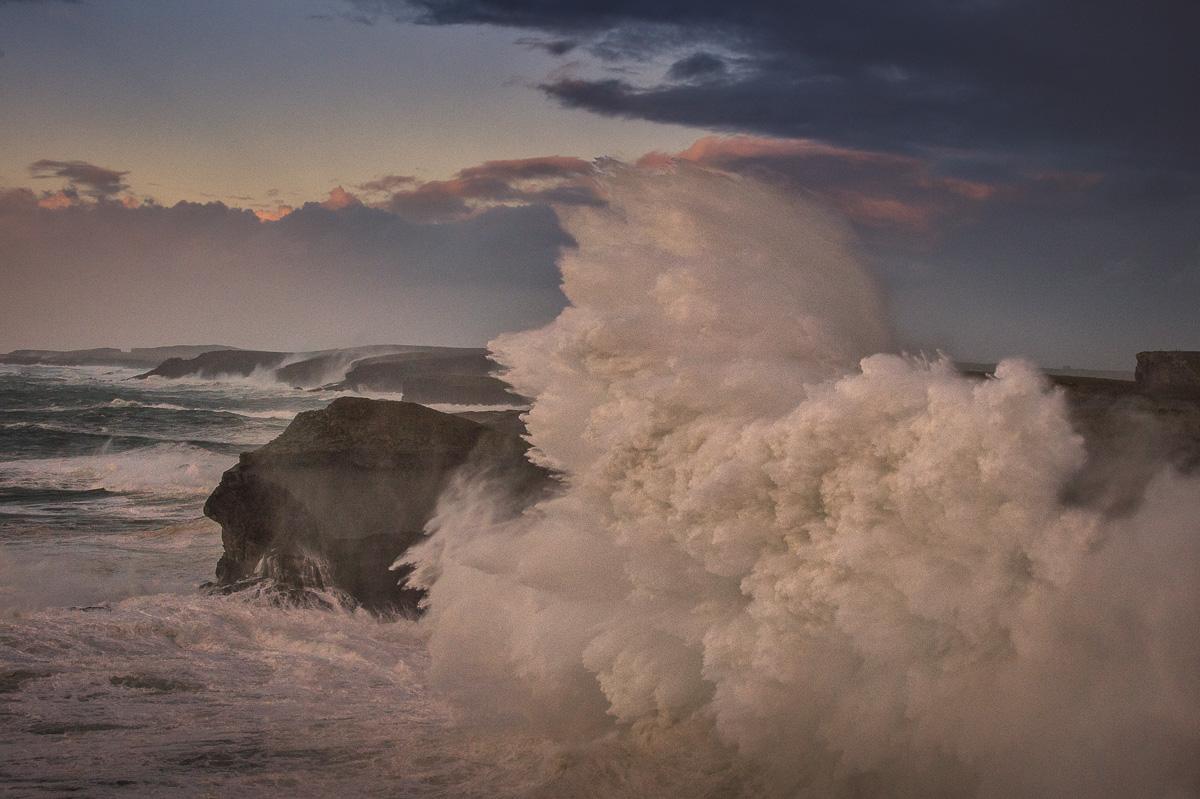 big storm waves crush cliffs at Kilkee