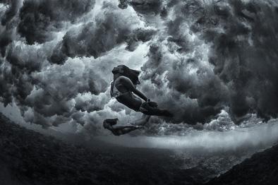 mermaid under wave cloud underwater