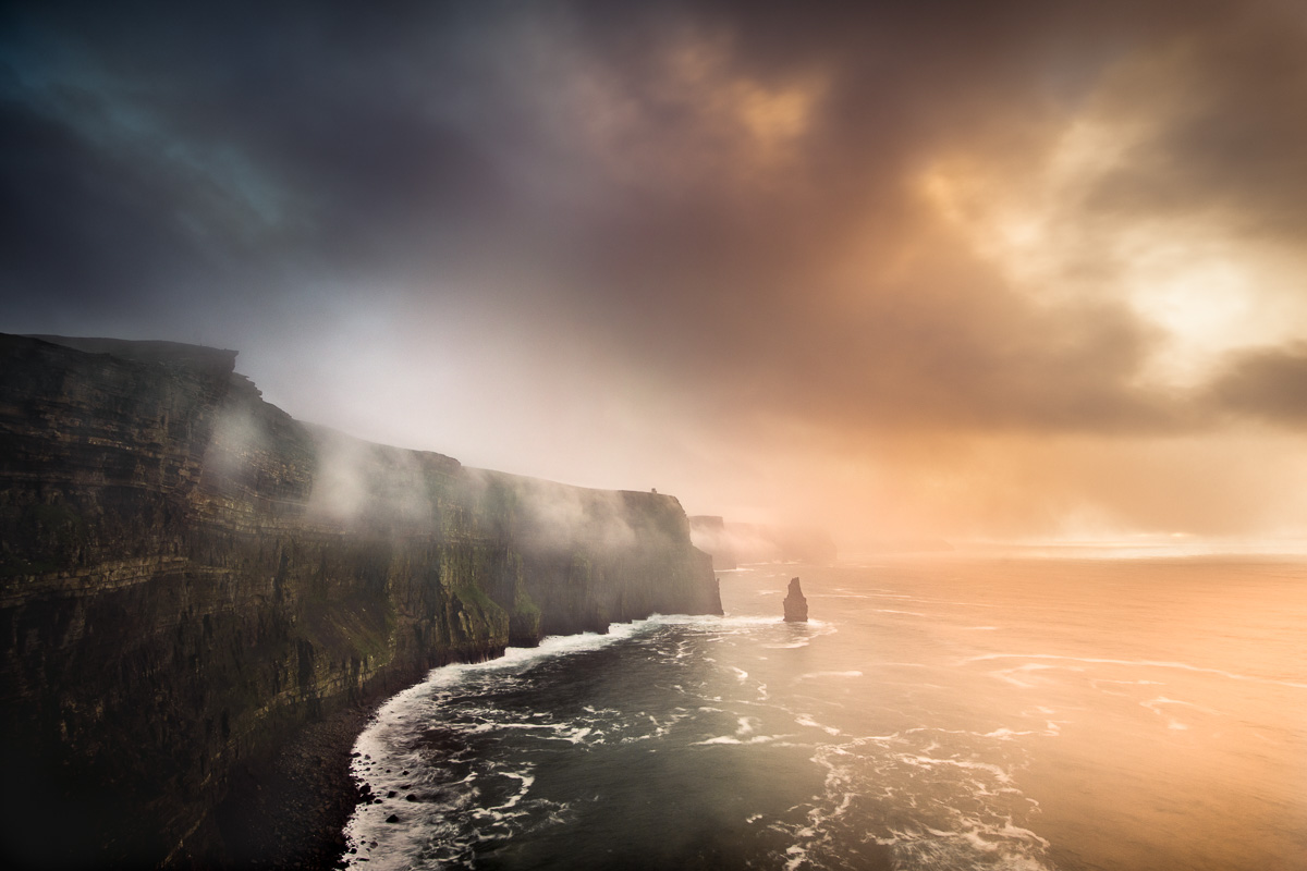 Misty Cliffs of Moher at sunset